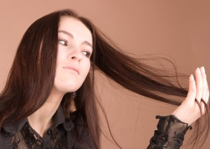 woman running hand through long hair